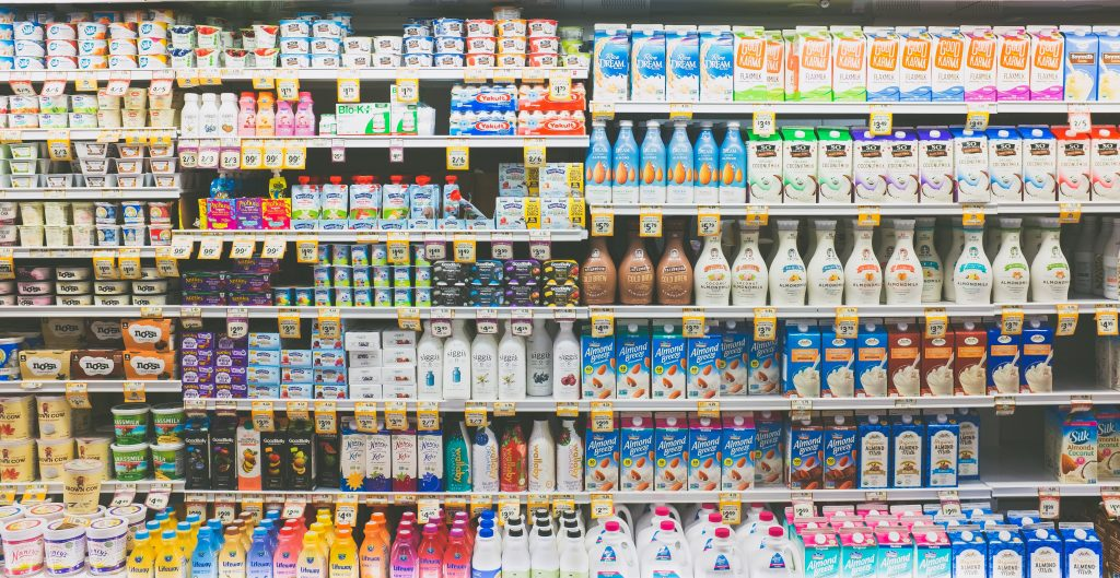 US grocery store milk aisle selling a variety of dairy products